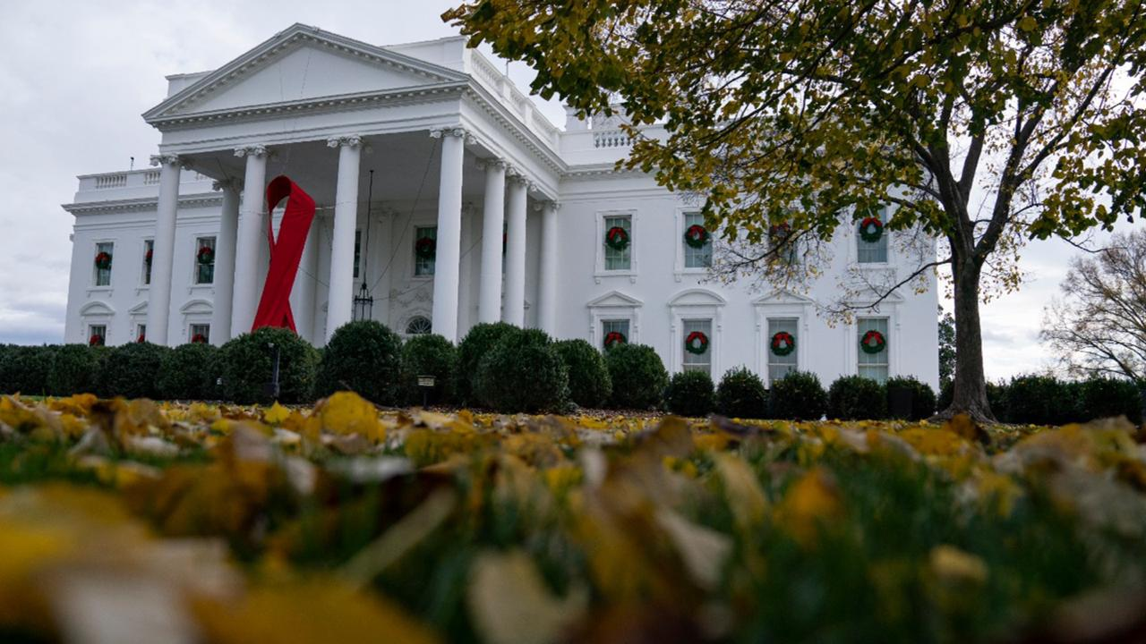 A ribbon hangs on the White House for World AIDS Day 2020, Tuesday, December 1, 2020, in Washington. (AP Photo/Evan Vucci)