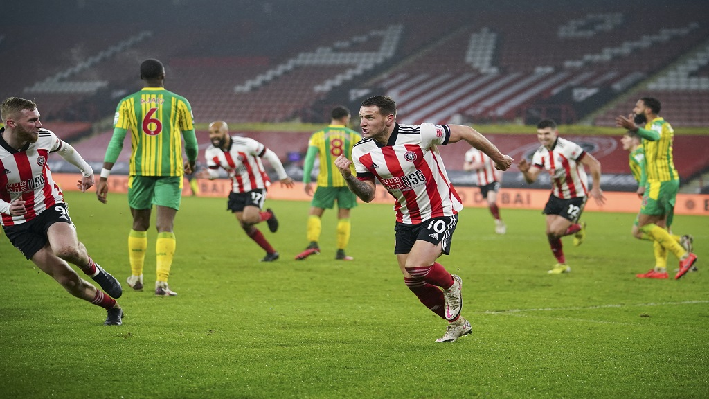 Sheffield United's Billy Sharp centre celebrates after scoring his side's second goal during the English Premier League football match against West Bromwich Albion at Bramall Lane stadium in Sheffield England Tuesday Feb. 2 2021. (AP