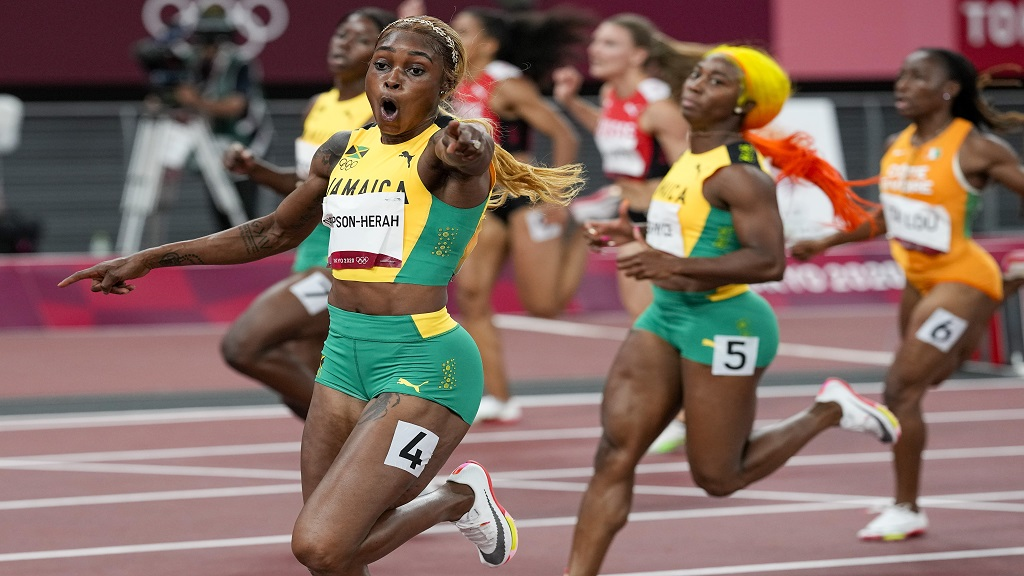 Elaine Thompson-Herah of Jamaica, celebrates as she wins the women's 100m final at the 2020 Summer Olympics, Saturday, July 31, 2021, in Tokyo. (AP Photo/David J. Phillip)