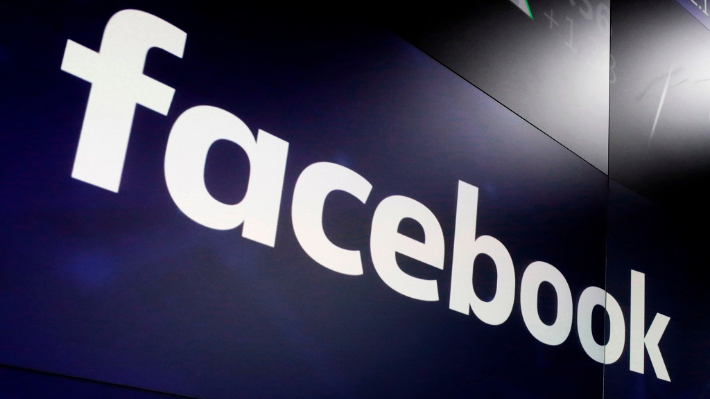 FILE - In this March 29, 2018, file photo, the logo for Facebook appears on screens at the Nasdaq MarketSite in New York's Times Square. (AP Photo/Richard Drew, File)