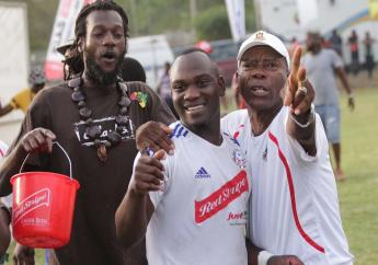 Portmore United midfielder Michael Binns (centre) celebrates after beating UWI to the RSPL final.