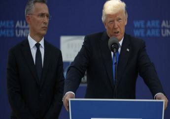 NATO Secretary General Jens Stoltenberg listens as President Donald Trump speaks during a ceremony to unveil artifacts from the World Trade Center and Berlin Wall for the new NATO headquarters, Thursday, May 25, 2017, in  Brussels.