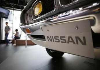 A Nissan car is displayed at its showroom in Tokyo Thursday, May 11, 2017. Japanese automaker Nissan Motor Co.'s fiscal year profit has improved 27 percent to 663.5 billion yen ($5.8 billion) as strong sales in the U.S., China and Europe offset damage from the strong yen.