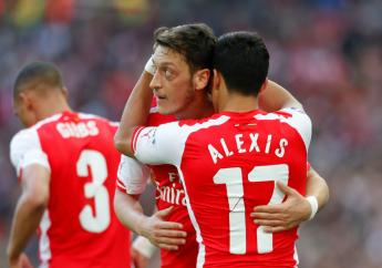 Arsenal goalkeeper Petr Cech believes the club can absorb missing out on the Champions League but must keep Mesut Ozil and Alexis Sanchez.