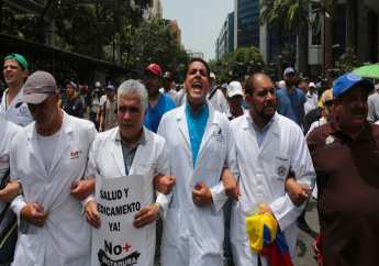Congressman and Doctor Jose Manuel Olivares yells as he marches with other medical professionals to the Health Ministry, to demand Venezuelan President Nicolas Maduro open a so-called humanitarian corridor for the delivery of medicine and food aid, in Caracas, Venezuela, Monday, May 22, 2017. (AP Photo/Fernando Llano)