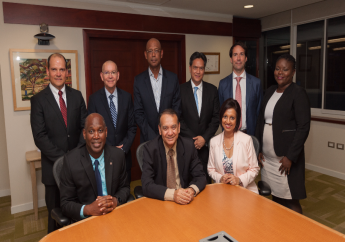 Sitting, from left: Norman Christie, bpTT; Honourable Franklin Khan, Minister of Energy and Energy Industries; and Nirmala Maharaj, Trinity
