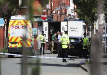 An army bomb disposal team works with members of the police in the Moss Side area of Manchester, England, Saturday, May 27, 2017. British police say they are evacuating residents around a house being searched in connection with the Manchester concert bombing. Police are searching a number of properties and have 11 suspects in custody in connection with Monday's explosion at an Ariana Grande concert in Manchester, which killed more than 20 people and injured dozens.