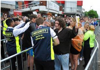 Courteeners' fans are searched as they arrive for a concert at Old Trafford cricket ground in Manchester, England, Saturday, May 27 2017. More than 20 people were killed in an explosion following a Ariana Grande concert at the Manchester Arena late Monday evening.