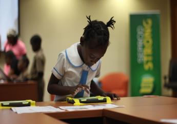 A student engages in an activity at the Scratch Day event last week.