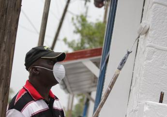 Volunteers travelled from Portmore to assist the police with their effort to repaint the facility.