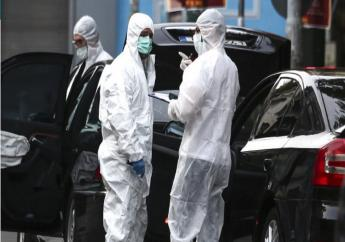 Greek police experts search for evidence at the scene of an explosion site in Athens, on Thursday, May 25, 2017. A bomb exploded inside the car of former Greek Prime Minister Lucas Papademos in central Athens on Thursday, wounding him and two Bank of Greece employees, officials said.