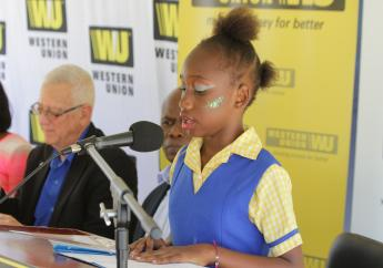 Michael's Primary School student at the launch of Western  Union 's literacy programme.