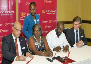 Managing Director, Retail and International Business, CIBC FirstCaribbean, Mark St. Hill (left) signs the agreement  while Chairman of the FirstPartnership Teresa Mortimer (second left) observes while Vice Chairman David Massiah (third left) signs on behalf of the unions, Managing Director Human Resources, CIBC FirstCaribbean, Neil Brennan (right) observes.