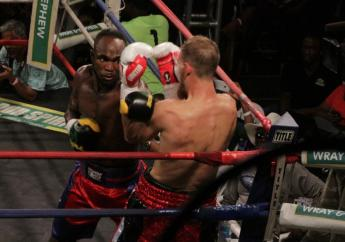 Jamaican Tsetsi Davis breaches the defence of Canadian Ryan Young during their quarter-final bout of the Contender Boxing Series on Wednesday night at the Chinese Benevolent Association.