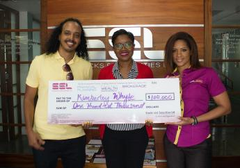Kimberley Whyte (centre) received a deposit of $100,000 to her Money Manager account during the chequepresentation held at SSL's head office in Kingston on Tuesday, with SSL's General Manager Lamar Harris, and SSL's 'Love My Money' social media ambassador, Sanjay.