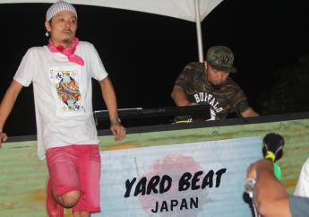 Desem (left) of Yard Beat looks dejected after the sound system's elimination from the Sound Clash. Also pictured is his partner Matta. (Photo: Marlon Reid).