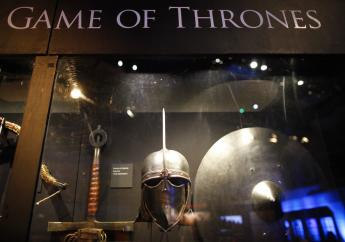 This is a Tuesday, June 10, 2014 file photo of weapons from the Game of Thrones are on display at the Waterfront Hall, Belfast, Northern Ireland. HBO in Spain has aired, apparently by accident, episode six of the seventh season of the immensely popular series, Game of Thrones, a week ahead of schedule. The episode was available to Spanish subscribers early Tuesday aug. 15, 2017, for about an hour before being removed. (AP Photo/Peter Morrison, File)