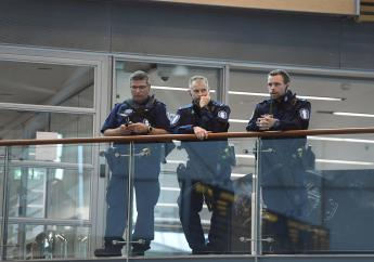 Armed Finnish policemen on guard at the Helsinki airport on Friday, Aug. 18, 2017, as Finnish authorities announced they will raise readiness levels after an incident in Turku Finland. Police in Finland say they have shot a man in the leg after he was suspected of stabbing several people in the western city of Turku.