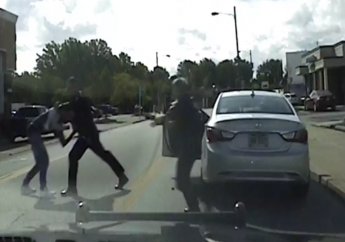 In this Saturday, Aug. 12, 2017 image taken from video provided by the Euclid Police Dept., Euclid police officer Michael Amiott grabs Richard Hubbard to arrest him on a street in Euclid, Ohio. (Euclid Police Dept. via AP)