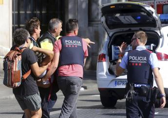 An injured person is carried in Barcelona, Spain, Thursday, Aug. 17, 2017, after a white van jumped the sidewalk in the historic Las Ramblas district, crashing into a summer crowd of residents and tourists and injuring several people, police said.