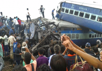 Railway police and local volunteers look for survivors in the upturned coaches of the Kalinga-Utkal Express after an accident near Khatauli, in the northern Indian state of Uttar Pradesh, Saturday, Aug. 19, 2017. (AP Photo)
