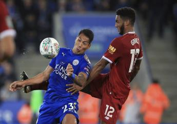 Leicester City's Leonardo Ulloa, left, and Liverpool's Joe Gomez battle for the ball during their English League Cup, third round football match at the King Power Stadium, Leicester, England, Tuesday, Sept. 19, 2017.