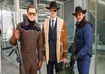 """This file image released by Twentieth Century Fox shows, from left, Taron Egerton, Colin Firth, and Pedro Pascal in """"Kingsman: The Golden Circle."""" The R-rated spy comedy """"Kingsman: The Golden Circle"""" has taken over the top spot at the North American box office with an estimated $39 million debut. The 20th Century Fox release pushed the Stephen King sensation """"It"""" into second place in its third week of release.(Giles Keyte/Twentieth Century Fox via AP, File)"""