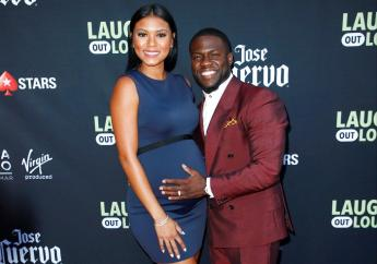"""In this Aug. 3, 2017, file photo, comedian Kevin Hart and his wife Eniko Parrish pose at Kevin Hart's """"Laugh Out Loud"""" new streaming video network launch event at the Goldstein Residence on in Beverly Hills, Calif. (Photo by Danny Moloshok/Invision/AP, File)"""