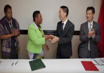 Sport Minister Olivia Grange and Chinese Ambassador Niu Qingbao signed a Letter of Exchange sealing a technical cooperation project on sports which will see the provision of Chinese coaches for seven sporting disciplines in Jamaica. Supporting the Minister is Dr Janice Lindsay, Acting Permanent Secretary in the Ministry (left), while Fan Jianghong, Counsellor, Economic and Commercial Counsellor Office, People's Republic of China Embassy accompanied the Ambassador (right).