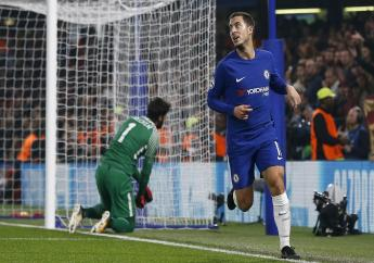 Chelsea's Eden Hazard celebrates after scoring during the Champions League Group C  match against Roma at Stamford Bridge stadium in London, Wednesday, Oct. 18, 2017.