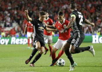 Benfica's Alejandro Grimaldo, center, fights for the ball with Manchester United's Ander Herrera, left, during their Champions League group A at Benfica's Luz stadium in Lisbon, Wednesday, Oct. 18, 2017.