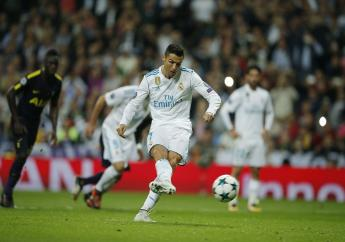 Real Madrid's Cristiano Ronaldo scores from the penalty spot during a Group H Champions League football match against Tottenham Hotspur at the Santiago Bernabeu stadium in Madrid, Tuesday Oct. 17, 2017.