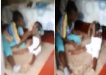 Screenshot of viral video showing a mother brutally beating her child.