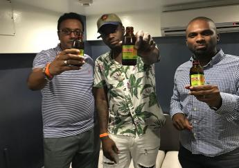 (From left) Abdel Ali, Managing Director ANSA McAL, Dancehall star Ding Dong, and Glen Rogers, Divisional Manager, Wines and Spirits, AMCO.