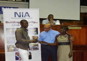 Jabary Williams (left) and his stepmother, Maureen Wright, seen here in 2016 receiving a gift from Trevor Munroe,  Executive Director of National Integrity Action (NIA), a not-for-profit NGO locally, that is dedicated to the building of integrity and combatting corruption in Jamaica.