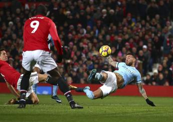 Manchester City's Nicolas Otamendi, right, scores his side's second goal during the English Premier League football match against Manchester United at Old Trafford Stadium in Manchester, England, Sunday, Dec. 10, 2017.