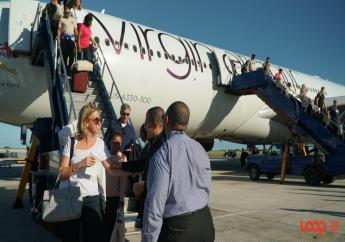 Tourism officials greeting passengers as they disembarked. (PHOTO: Richard Grimes)