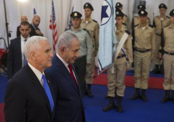 U.S. Vice President Mike Pence walks with Israel's Prime Minister Benjamin Netanyahu in Jerusalem. (AP Photo/Ariel Schalit)