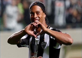 In this July 11, 2013 file photo, Brazil's Atletico Mineiro's Ronaldinho celebrates his team's victory over Argentina's Newell's Old Boys at the end of a Copa Libertadores semifinal football match in Belo Horizonte, Brazil.