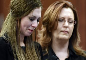 Dancer Jessica Smith, left, reacts while speaking Thursday, Jan. 18, 2018,in Lansing, Mich., during the third day of victim impact statements regarding former sports medicine doctor Larry Nassar, who pled guilty to seven counts of sexual assault in Ingham County, and three in Eaton County. Next to her is her mother Kimberly.