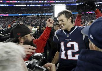 New England Patriots defensive coordinator Matt Patricia, left, reaches to embrace New England Patriots quarterback Tom Brady after the AFC championship NFL football game against the Jacksonville Jaguars, Sunday, January 21, 2018. (PHOTO: AP)
