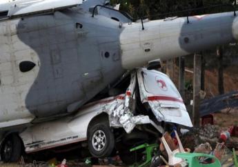De helikopter stortte neer bij de landing foto:ANP
