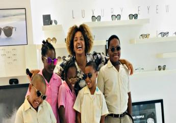 The Lead Optician and owner of Eye-Q Stylist Opticians, Alicia Hartman with some of the students during their visit.