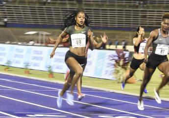 Jamaican Elaine Thompson (left) wins the women's 100 metres at the Jamaica International Invitational Meeting at the National Stadium on Saturday night. (PHOTO: Marlon Reid).