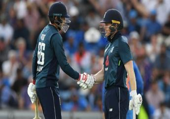 England's Joe Root (left) and Eoin Morgan in action against India.