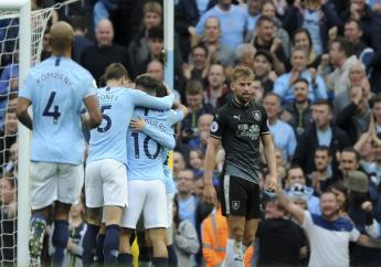 Manchester City's Bernardo Silva celebrates with teammates after scoring his side's second goal during the English Premier League football match against Burnley at Etihad stadium in Manchester, England, Saturday, Oct. 20, 2018.