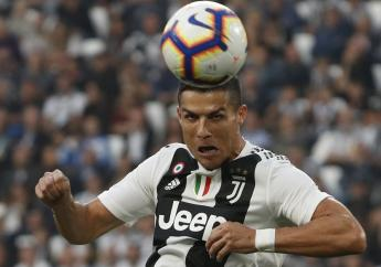 Juventus' Cristiano Ronaldo heads the ball to hit the post during an Italian Serie A football match against Genoa, at the Alliance stadium in Turin, Italy, Saturday, Oct. 20, 2018.