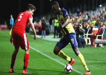 Usain Bolt (right) on the ball.
