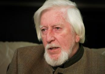 """In this April 10, 2008, file photo puppeteer Caroll Spinney is interviewed during a break from taping an episode of """"Sesame Street"""" in New York. (AP Photo/Mark Lennihan, File)"""