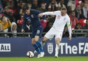 England's Wayne Rooney fouls Unites States Jorge Villafana during the international friendly football match against the United States at Wembley stadium, Thursday, Nov. 15, 2018.
